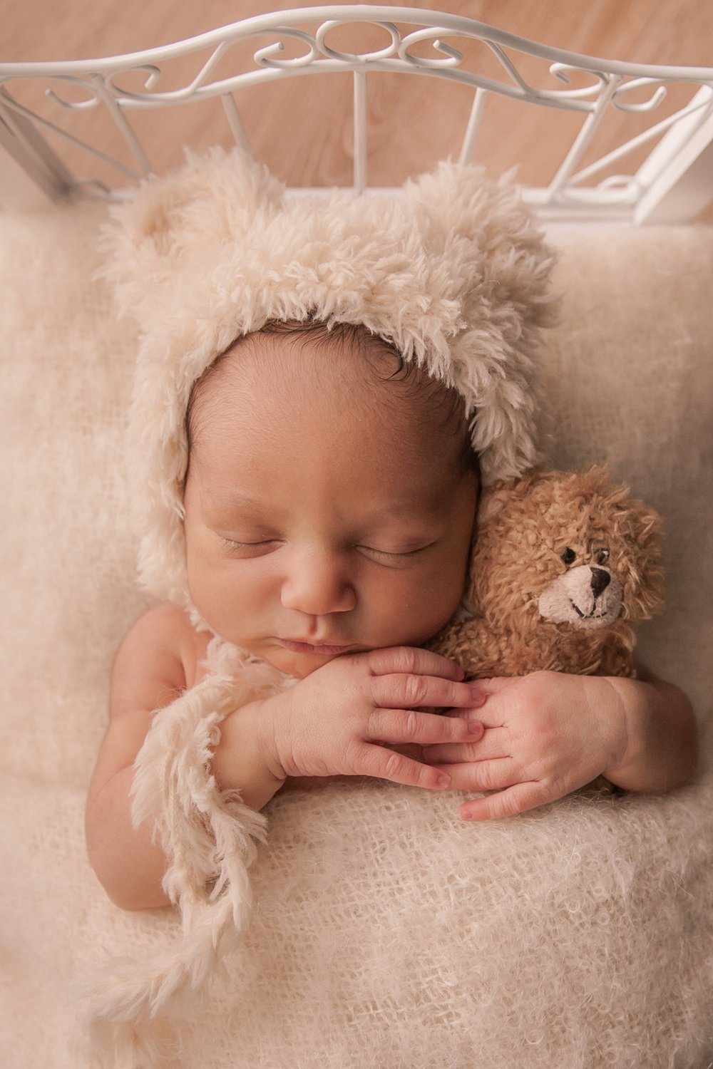 """""""She is so meticulous with every detail, I felt at ease letting her take complete creative control of the entire shoot. Her studio provides all of the props, adorable bonnets, and wraps to choose from for the newborn session."""" - —MARGARET, FRAMINGHAM, MA (GOOGLE REVIEW, 2018)"""