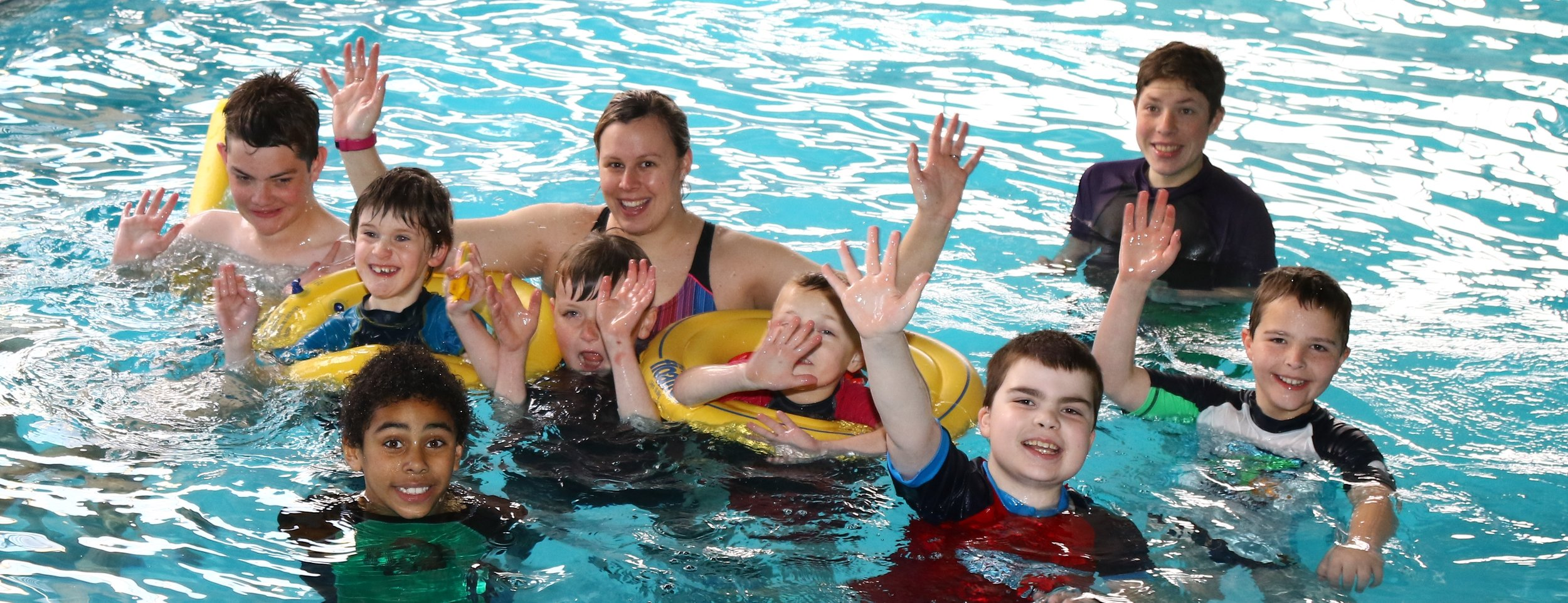 Giant Steps pupils with teacher enjoy the new heating in their pool