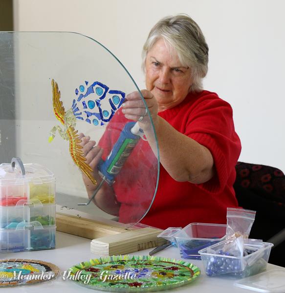 Linda Ireland works on a mosaic cropped