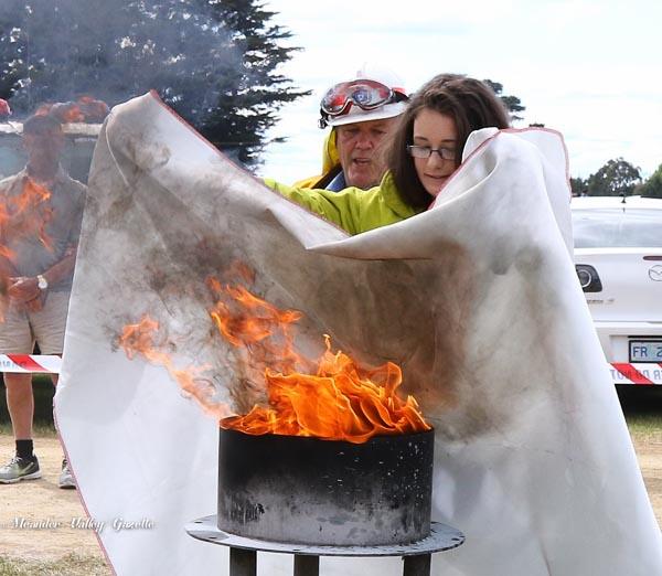 Kara Van Dijk aged 15 of Westbury with Fireman Bill Barber fire blanket demo