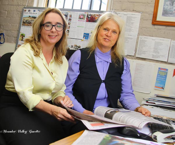Michelle O byrne  and Joanne Eisemann look at a copy of Meander Valley Gazette