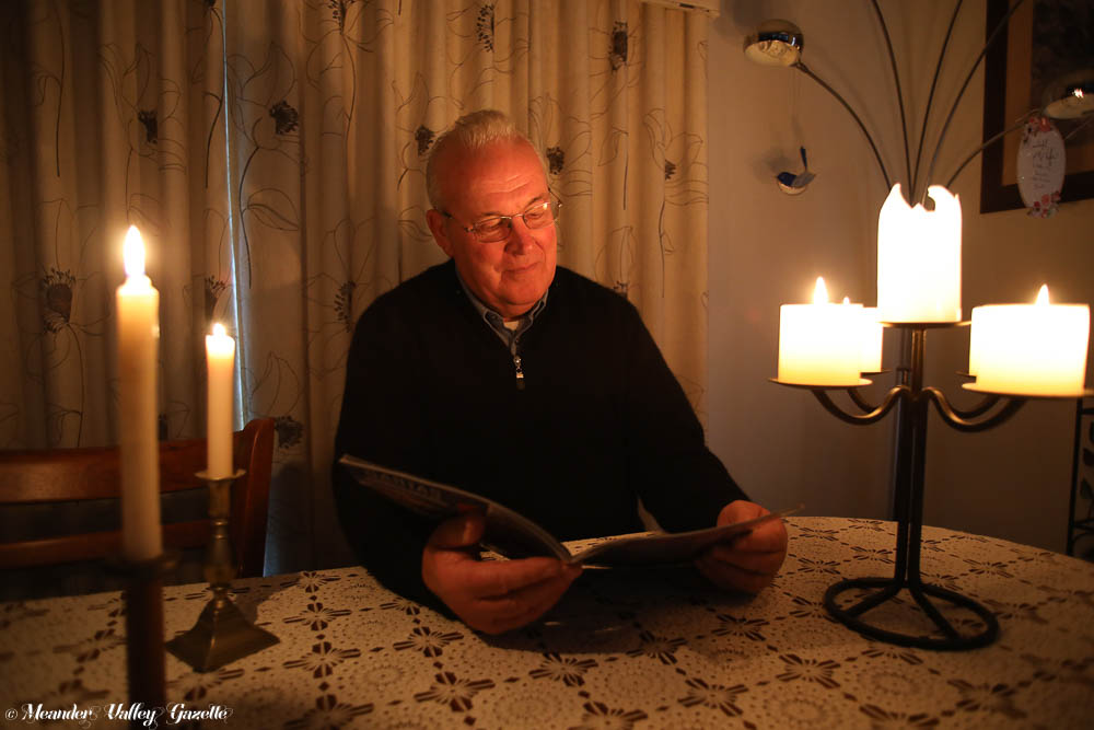 Albert-DeVeth-is-getting-used-to-reading-by-candlelight-during-the-many-power-outages-being-experienced-in-Westbury.jpg