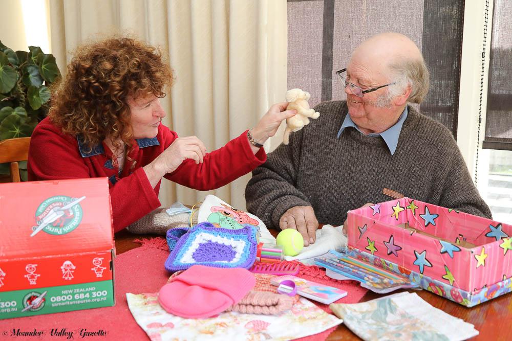 Bernadette-Whitcombe-and-Mark-Leonard-work-together-packing-good-samaritan-boxes.jpg