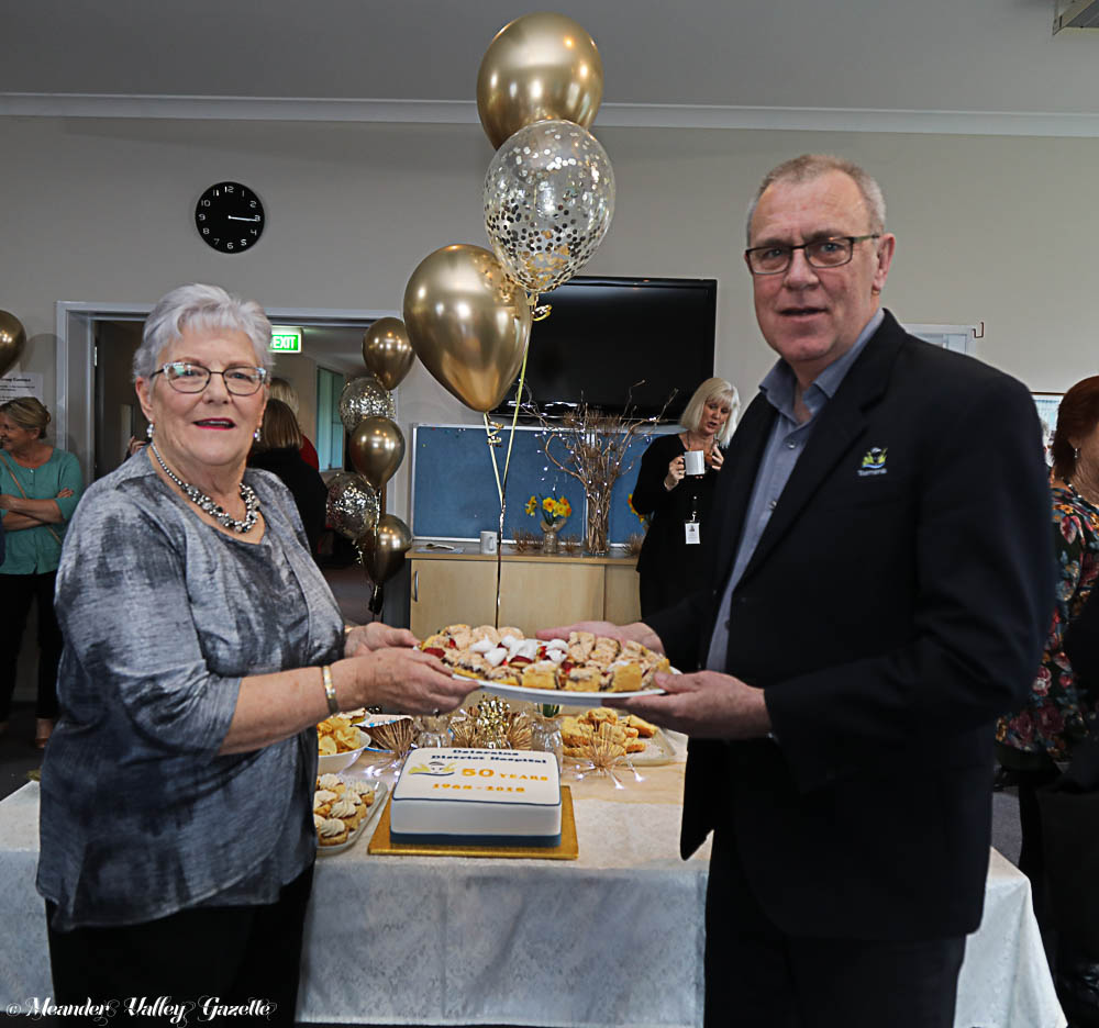 One of the original Deloraine District Hospital nurses, Liz Archer indulges in some food therapy with Director of Nursing and Manager, Lester Jones.