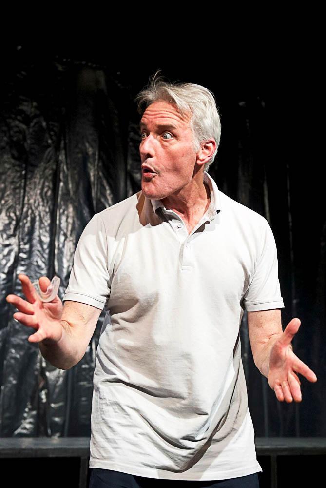 Actor Guy Hooper performs.