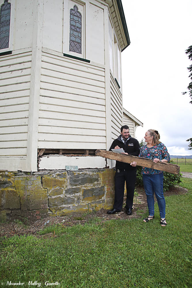 Simon Rootes, Manager of Deloraine & Districts Community Bank Branch, discusses repairs to the Parkham Church with Sharman Lewis, Parkham Community Inc. Photo by Mike Moores
