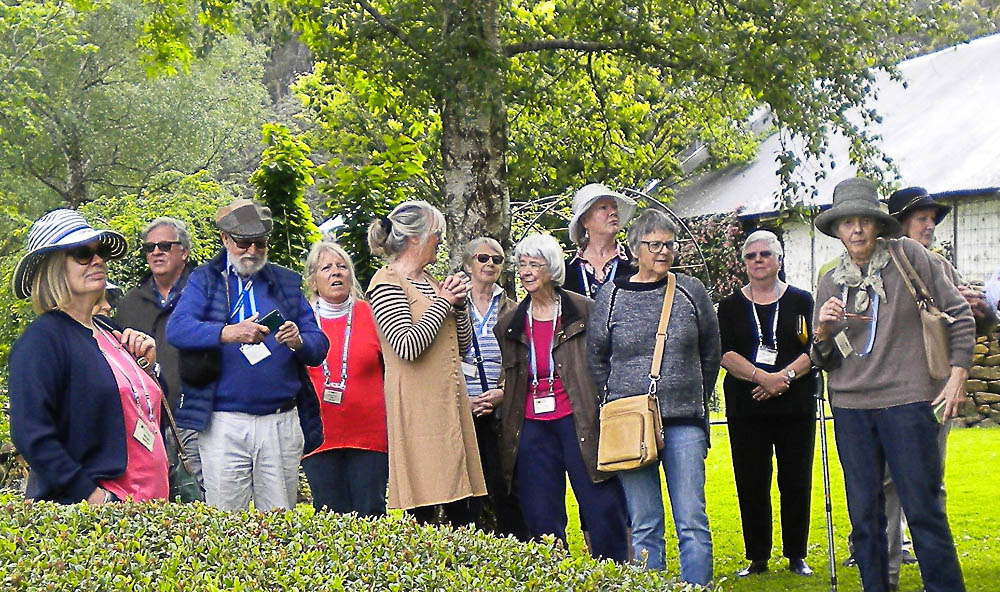 Deb Wilson (fawn dress) shows a group of Victorians around the gardens at Old Wesleydale. Photo by Tom Comerford