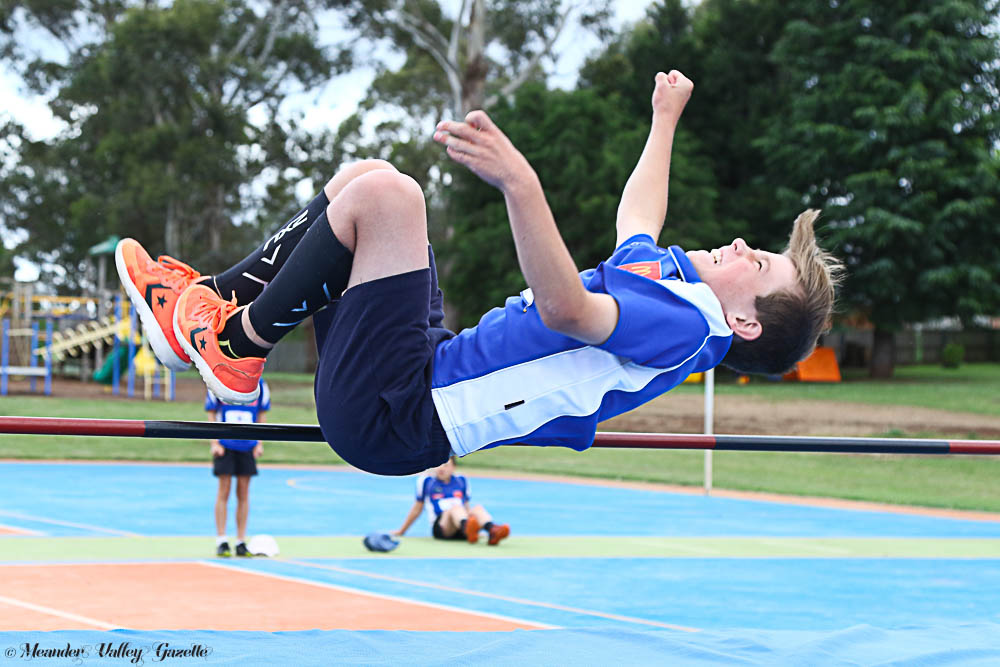 Corey Horsburgh trying out Deloraine Little Athletics new high jump mat with a Fosbury flop. Photo by Mike Moores