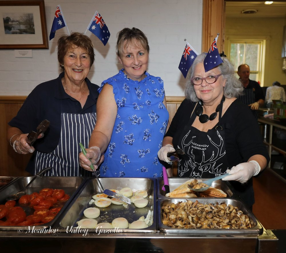 From L-R: Sue Poulton, Alison Lee and Dinah Fitzgerald feed the hungry hoards at Westbury.   Photo | Mike Moores