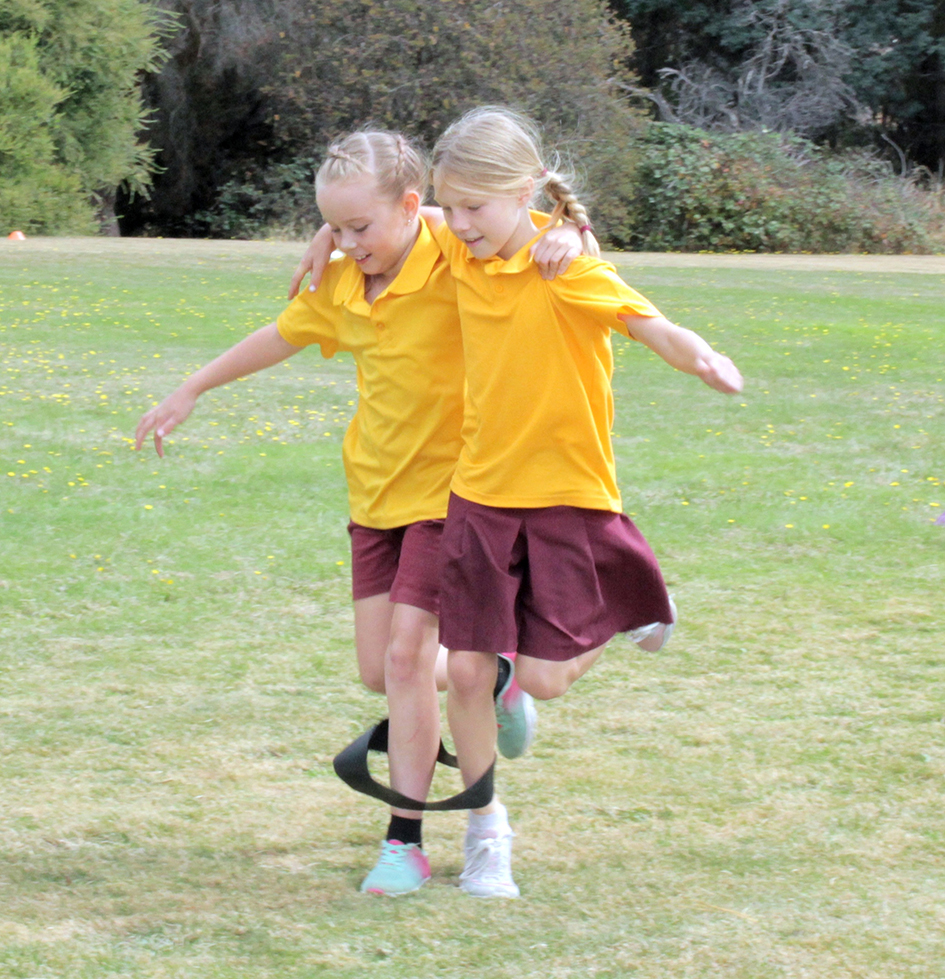 Isabella Sullivan-Taylor (8) and Katalina Wynn (9) competing in the 3 legged race at Bracknell Primary School Sports Carnival.   Photo | Hayley Manning