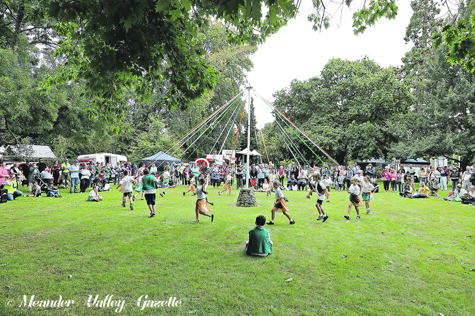 Westbury Primary School enjoying traditional maypole dancing in front of an appreciative audience on the Village Green.   Photos | Mike Moores