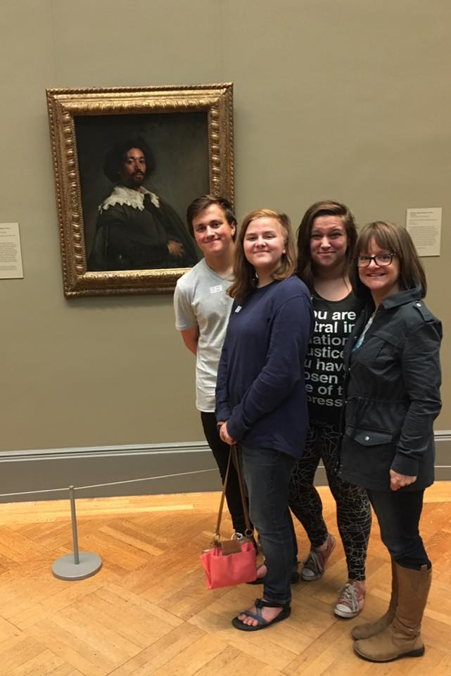 Mindy and her family in front of The Juan de Pareja painting at the Met.