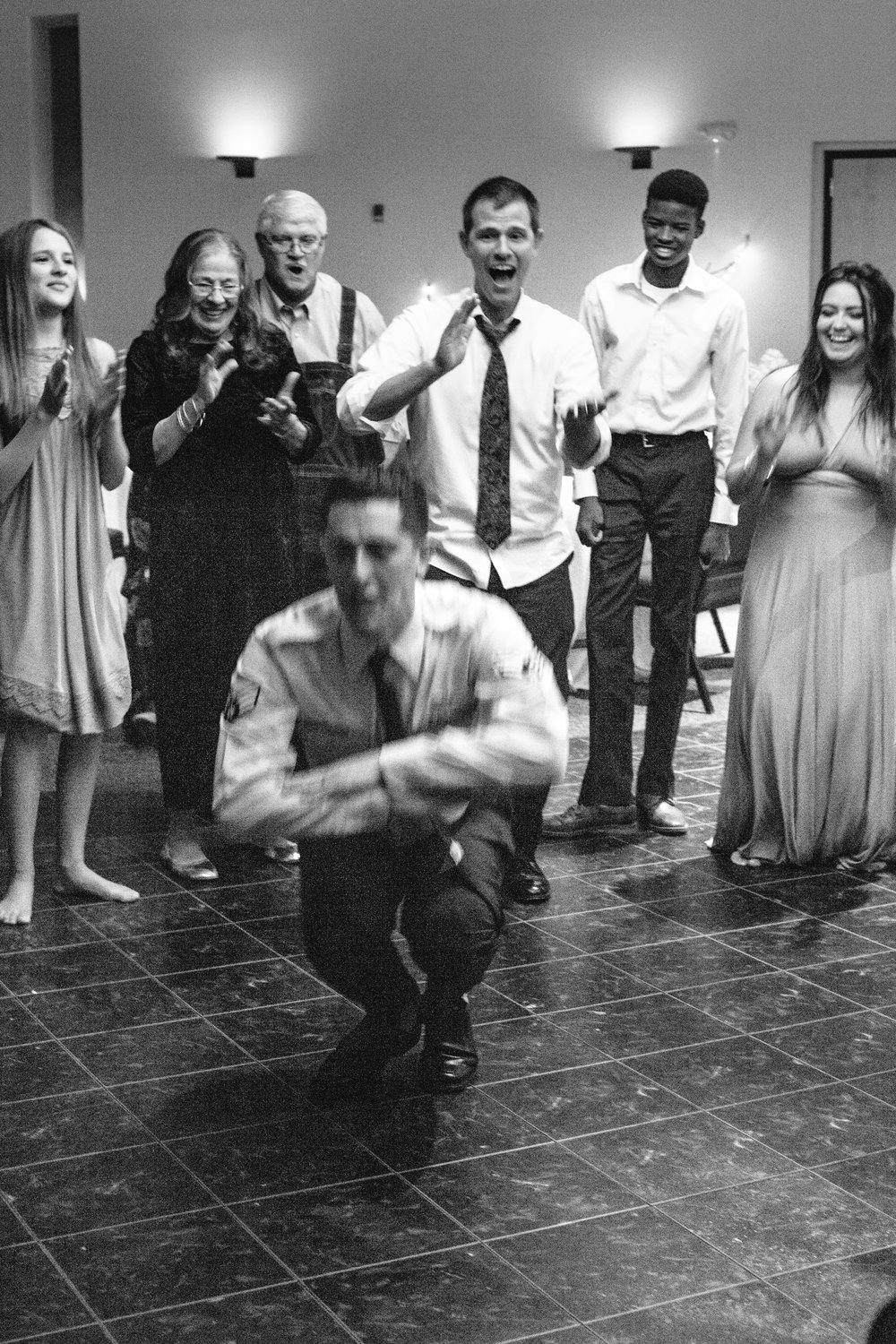 Looking at the faces surrounding the key dancers is one of my favorite wedding games.