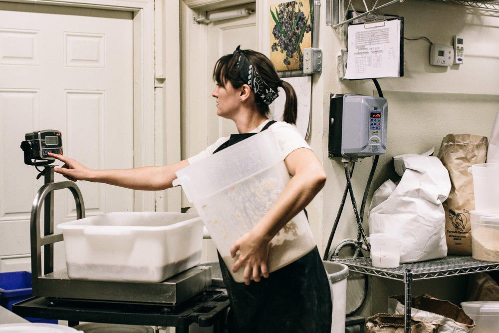 Because of all the lifting and hauling involved in running a bakery, it is necessary to know the best way to do the heavy lifting without throwing out one's back. One of the bakers mentioned that she actually works out outside of work to equip her for the job.