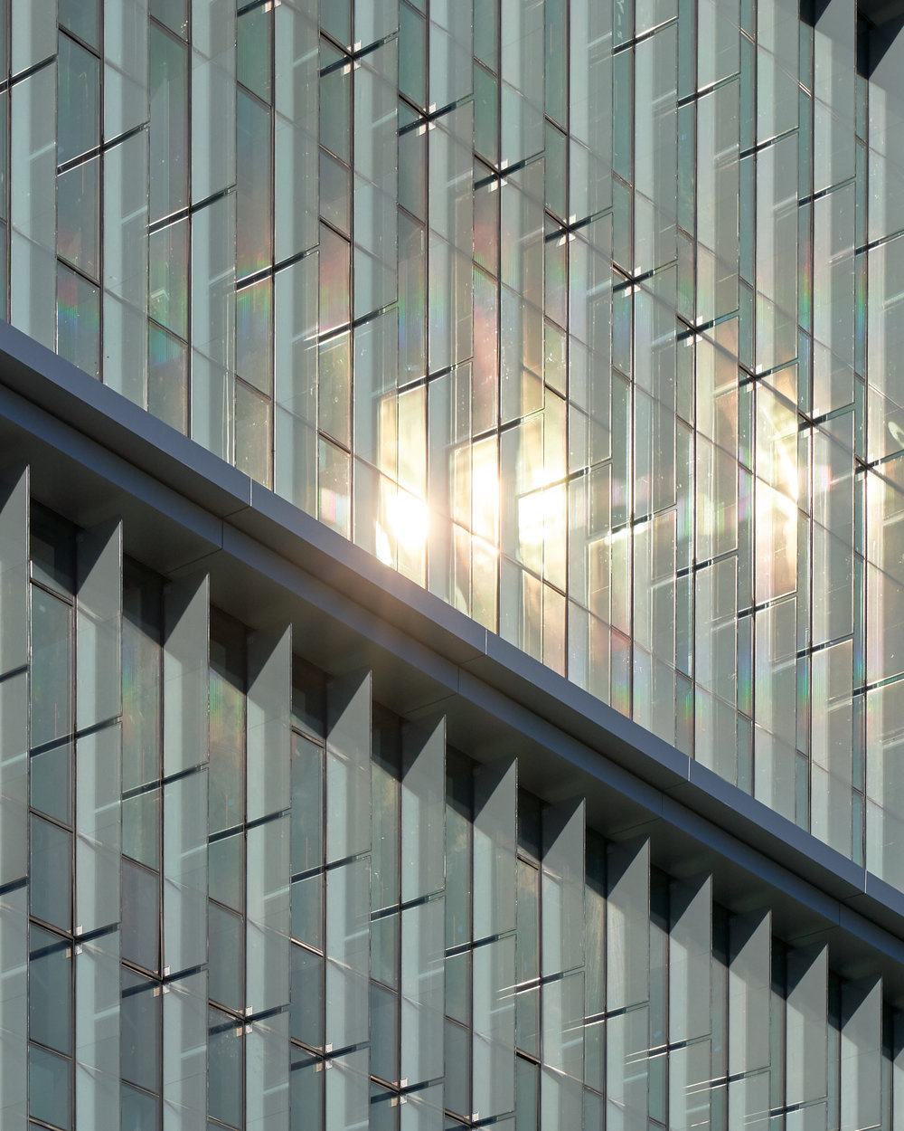 Northwest orientation of glass solar fins: shading reduces solar heat gain from low afternoon sun in summer