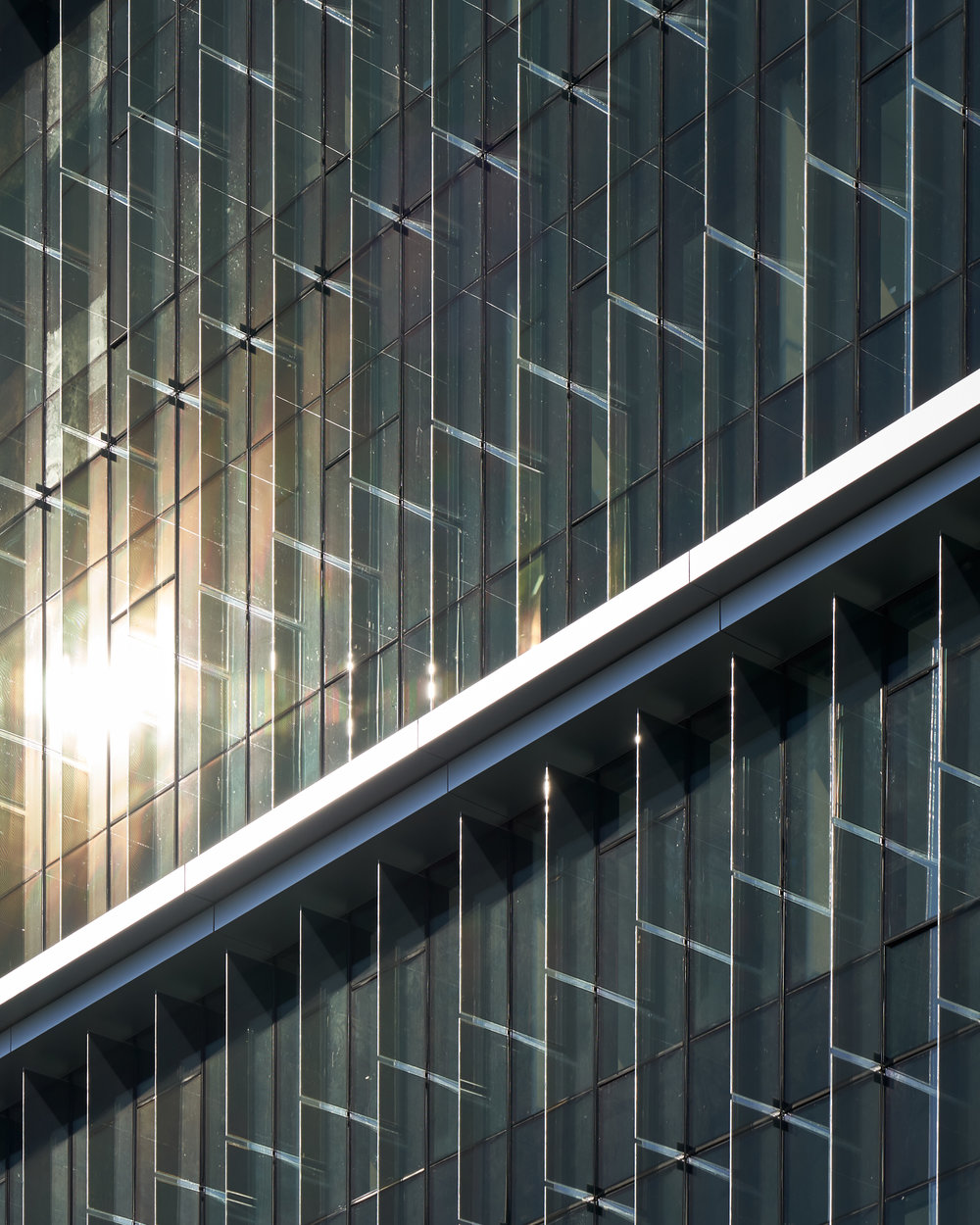 Southeast orientation of glass solar fins: produce energy from sunshine even with overcast skies