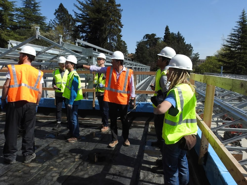 University of Washington Solar Student Group on a construction tour witnessing installation of innovative sustainable systems they helped initiate during design and fund with grants.