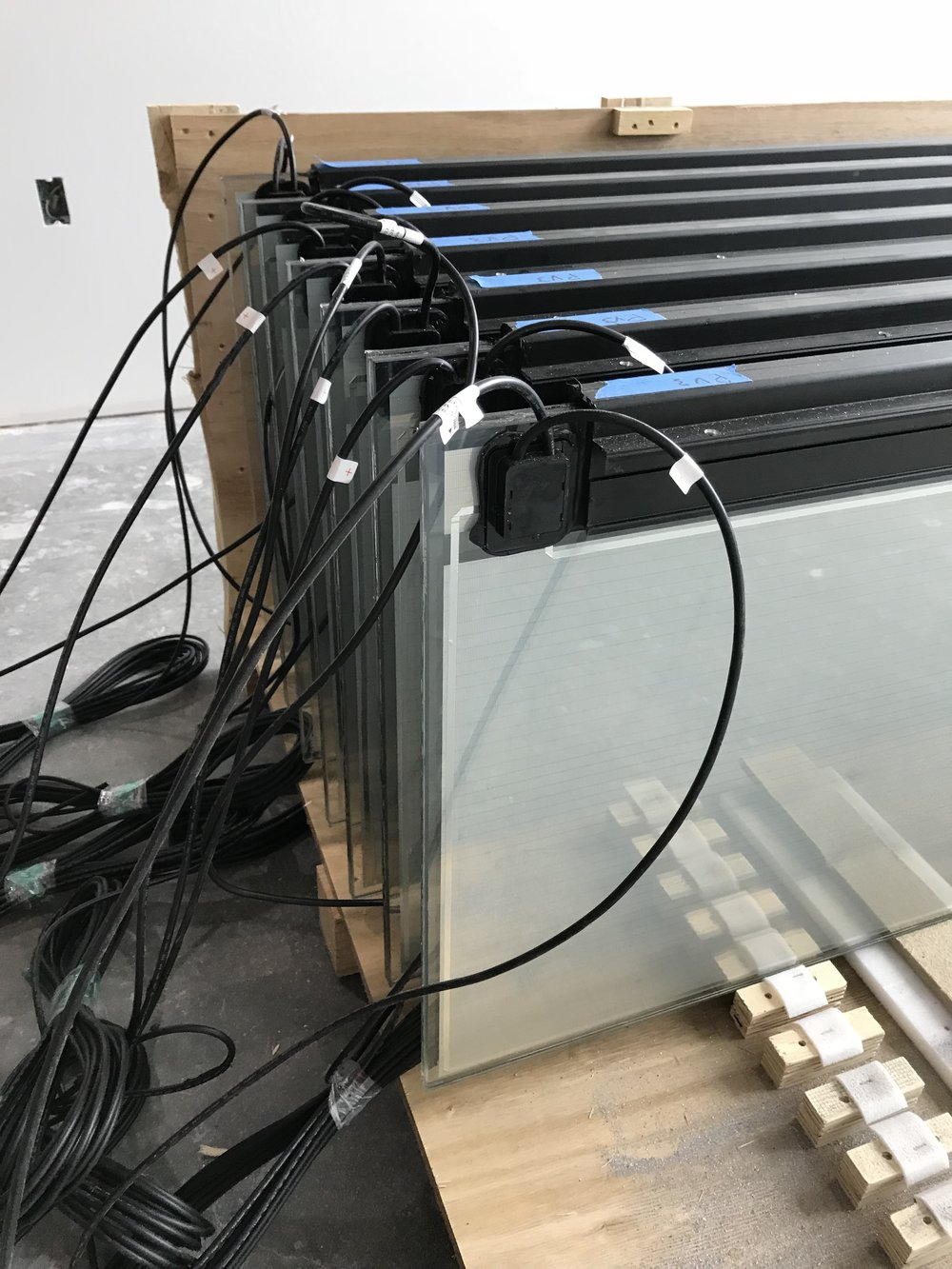 Solar glass fins with electrical connections stored before installation