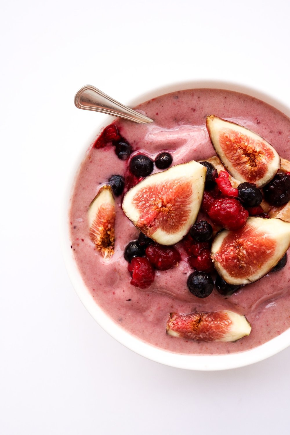 BERRY + FIG SMOOTHIE BOWL - INGREDIENTS:3 fresh figs2 frozen banana1/2 cup frozen or fresh berriesDIRECTIONS:Add ingredients to your blender & mix it all up. If you used frozen berries, add 1/4 cup of water or plant milk to help the blender mix it well. Then, pour into a bowl and add your toppings of choice!