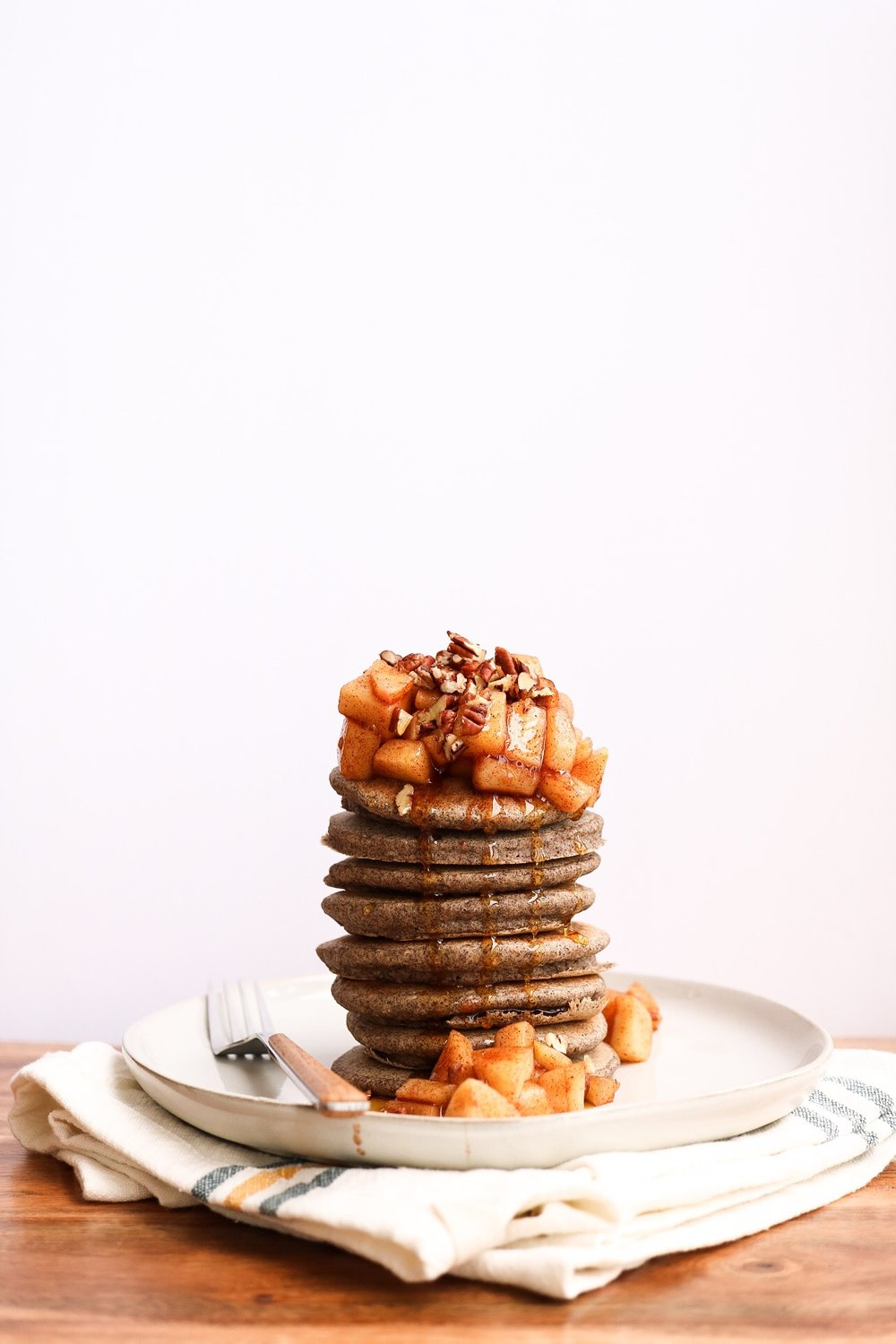 Apple Pie Buckwheat Pancakes - PANCAKE INGREDIENTS:1/2 cup buckwheat flour1/2 oats1/2 ripe banana1 cup water1/2 tsp cinnamon1 Tbsp apple cider vinegar1 Tbsp baking powder1 Tbsp flaxseedAPPLE TOPPING:1 apple, chopped1 Tbsp maple syrup1/4 cup waterINSTRUCTIONS:For the pancakes, combine all of the ingredients in a. food processor and blend until smooth - let the pancake batter sit for about 10 minutes. Then, preheat your pan at medium heat for about 1-2 minutes, adding a teaspoon of coconut oil to the pan if needed. Then, just cook the pancakes as you would normally! As for the apple topping, just add the ingredients to a small saucepan and bring it all to a simmer - let the apple mix cook for about 3 minutes, until the apples are soft and sticky.