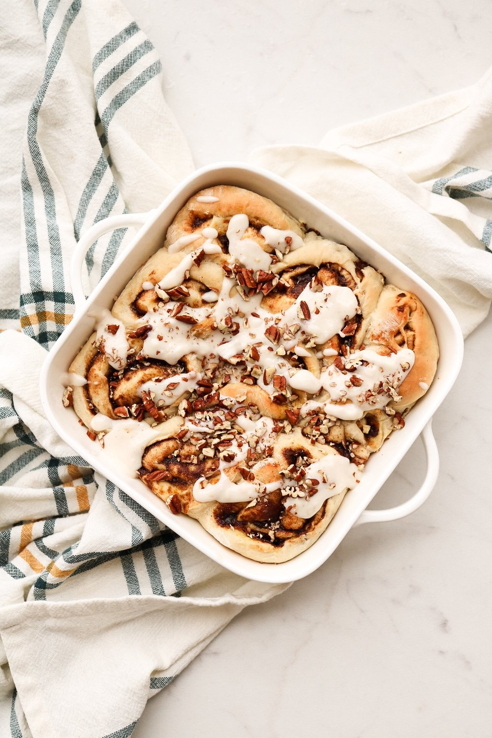 Pumpkin Cinnamon Rolls - INGREDIENTS:Dough:1 cup warm water2 packets instant dry yeast1/4 cup melted coconut oil2 Tbsp sugar1/2 tsp salt2 cups all purpose flourFilling:1/2 cup sugar4 Tbsp pumpkin puree1/2 Tbsp cinnamon1/4 tsp nutmegINSTRUCTIONS:In a large bowl, mix together the warm water and the yeast. Allow this mixture to sit for about 5 minutes, so that the yeast has a chance to activate. Once some bubbles has formed, add in the oil, sugar, salt, and flour. Mix this all together, until a dough has formed. Flour your counter or surface, and roll out your dough. Roll it into a rectangular size, and about a 1/2 inch thick - not too thin, and not too thick! Over the top, spread our your pumpkin puree in an even layer. In a small bowl, combine the sugar, cinnamon, and nutmeg, and then sprinkle this all over the pumpkin puree. Then, just roll up the dough into a log, and slice it into even slices. Place your cinnamon roll wheels into an 8x8 baking pan, and allow the rolls to rise in a warm place for about half an hour. In the meantime, preheat your oven to 350F, and once the rolls have risen, allow them to bake for 25-30 minutes, until slightly golden brown on top.