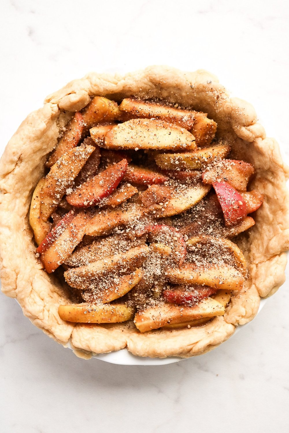 Once the apples are mostly cooked, place them into your crust.