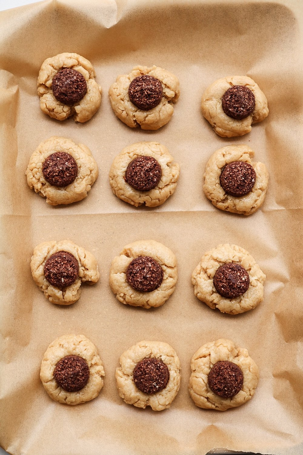 Place a coco-roon into the center of each cookie - then, just bake!