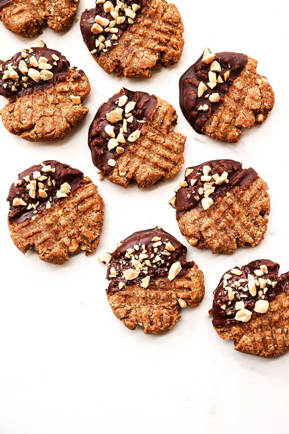 Dip them into dark chocolate and sprinkle chopped peanuts on top.