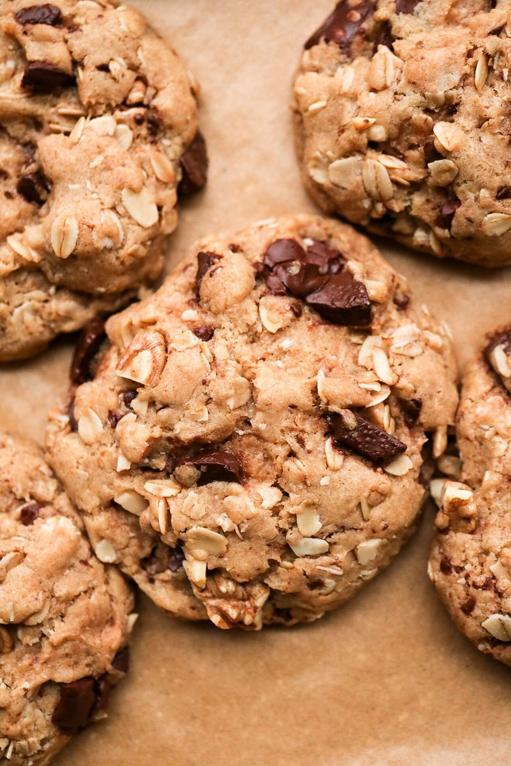 Chocolate Chunk Walnut Oatmeal Cookies - INGREDIENTS:1 cup all purpose or spelt flour1/2 tsp baking powder1/4 tsp baking soda1/2 tsp salt1/3 cup melted coconut oil2/3 cup brown sugar1/4 cup warm water1/3 cup chopped chocolate1/2 cup rolled oats1/3 cup chopped walnutsINSTRUCTIONS:Preheat your oven to 350F. Line a baking pan with parchment paper and set aside. In a bowl, whisk together the flour, salt, baking soda, baking powder, and set aside. In another bowl, combine the sugar, melted oil, and warm water. Add the wet mixture to the dry, and mix. Fold in the chocolate, oats, and walnuts, and form cookie dough balls to place on your pan. The batter should make around 10-12 cookies. Bake for 12-14 minutes, depending on how crispy you like them.