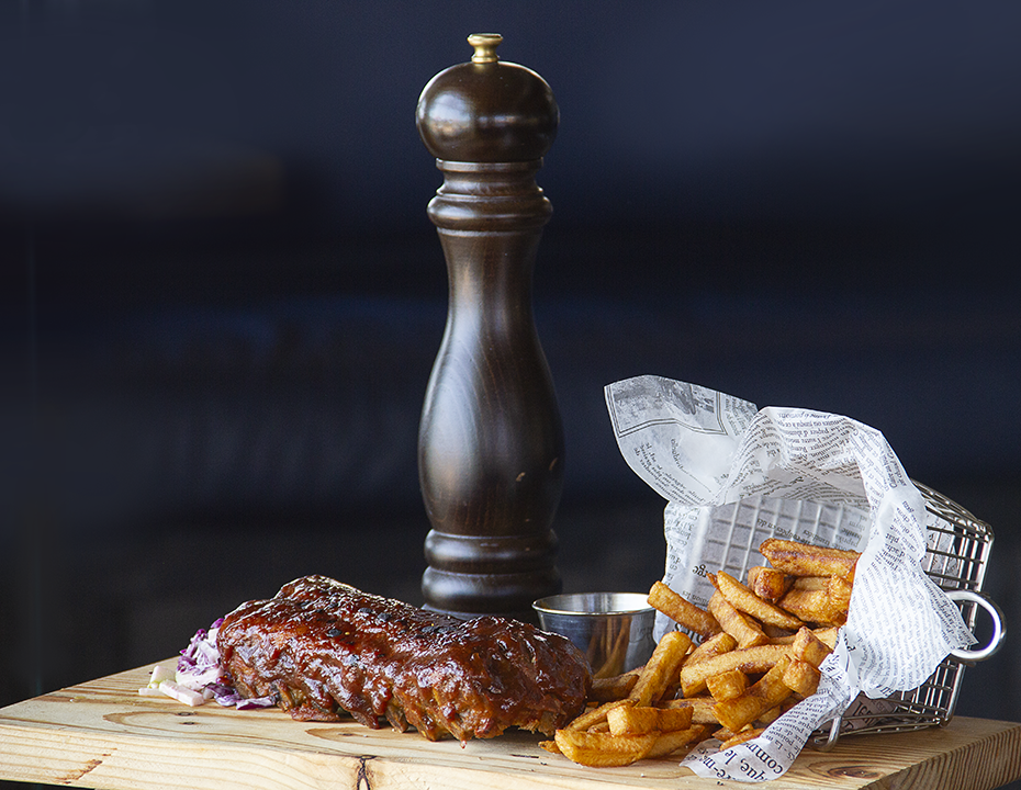 - Ribs Marinated in pit caribou black beer & maple syrup, served with french fries - - Ribs Marinated