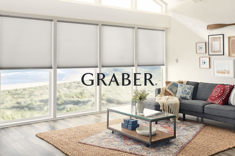 A beach-side home with Graber Cellular Shades, Graber logo overlaid