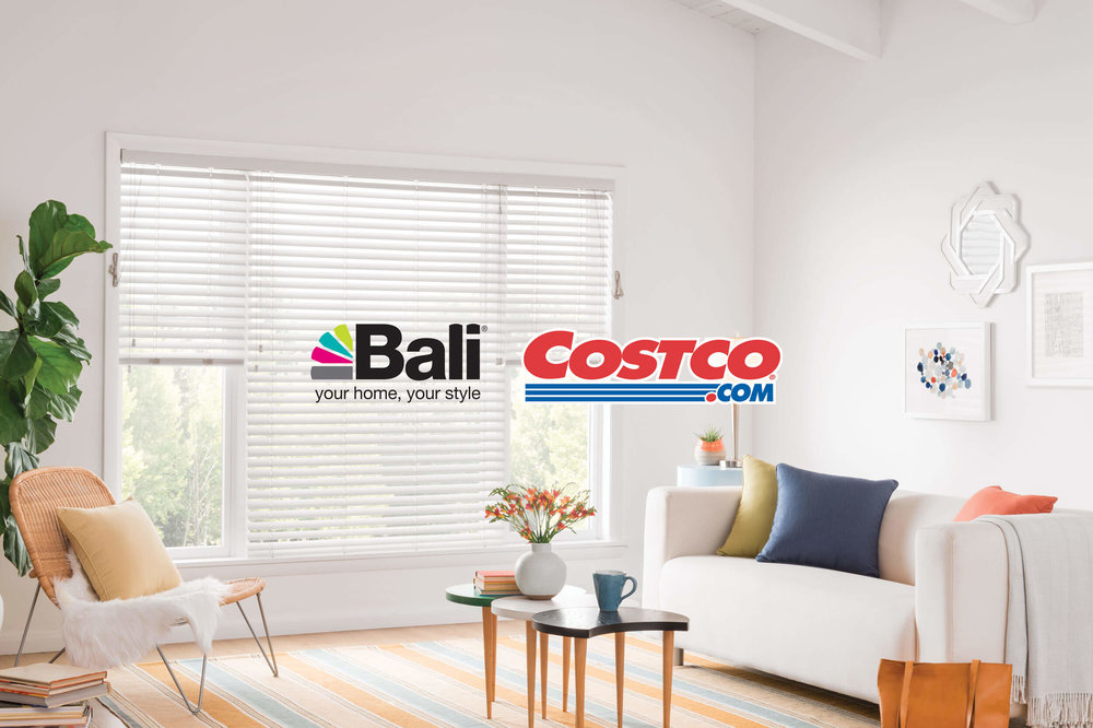 Bali Horizontal Blinds in a bright living room with the Bali and Costco logos overlaid