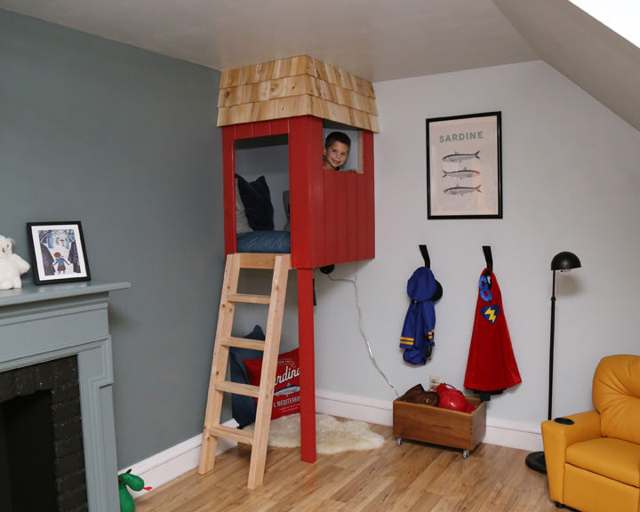 The two-story reading nook is my favorite part of the room. The cedar shingles and red siding add texture and color to the room. We had planned on doing steps instead of a ladder, but ran out of time. Brady added a hand grip to the top of the ladder to make it safer for the kids and I made two denim cushions so the boys will be comfortable when they are reading.