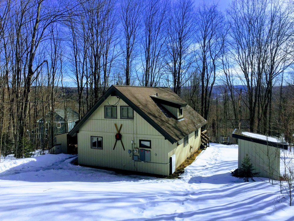 Winter view of the house from driveway