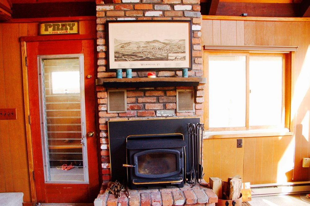 Wood burning stove & chimney, mudroom in background