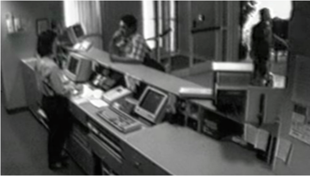 Surveillance footage of Blair purchasing a room at the Fairfield Inn.