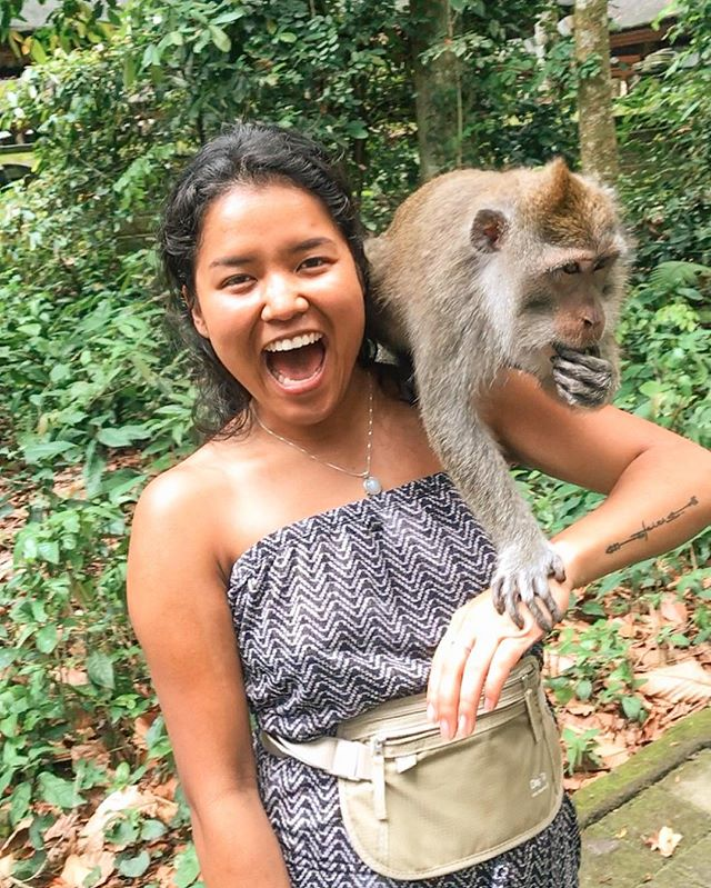 Pictured: me and Balinese monkey looking like we are the best of friends . . . . Not pictured: Balinese monkey peeing on my back shortly after this photo was taken  Lesson: when it comes to social media, always use your discernment. Not everything is what it seems 🤣😭😂 . . . . The locals said it's very rare that it happens so when it does, it's a sign of good luck.  Sure. I'll take that.