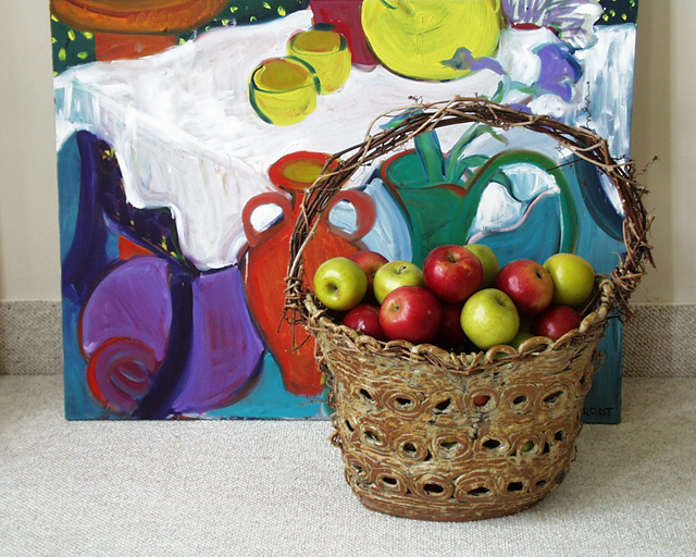 """Pot with apples in front of Painting"""