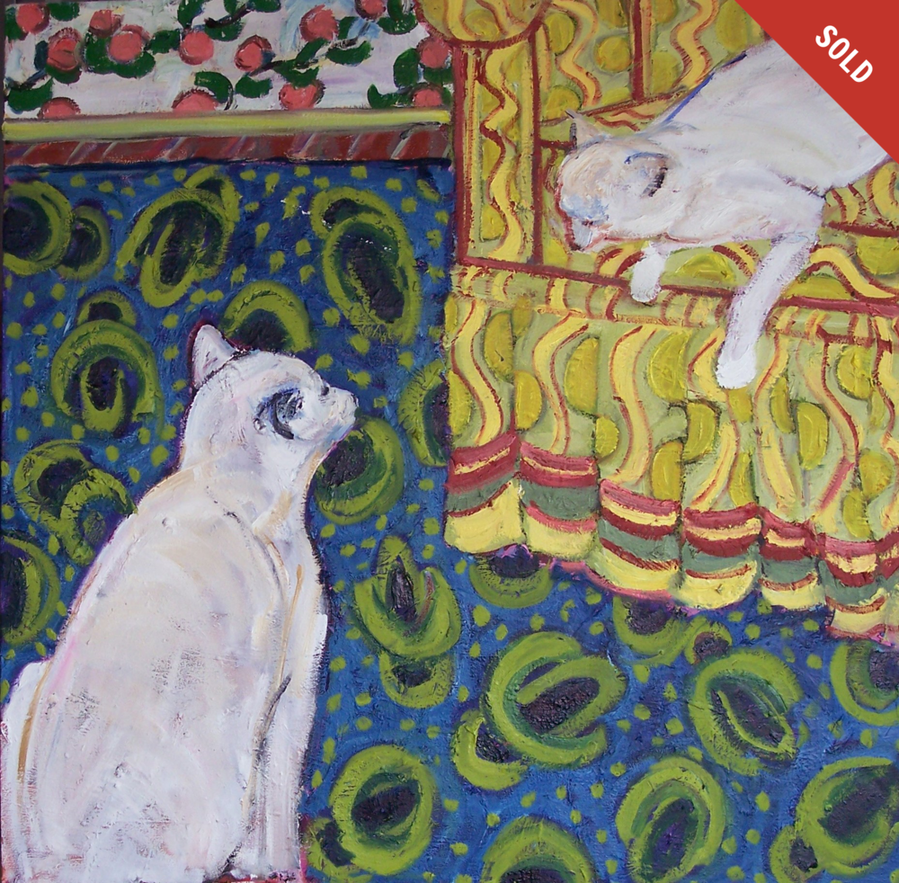 Two Cats on a Blue and Yellow Rug