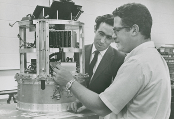 Brian O'Brien, left, then a Rice professor, and his student David Reasoner work on a moon-bound experiment in the 1960s. Photo courtesy of the Fondren Library