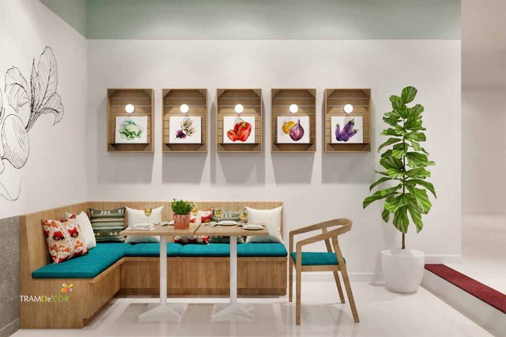 Sử dụng nhiều tranh treo tường trang trí nội thất nhà hàng chay thêm ấn tượng hơn.