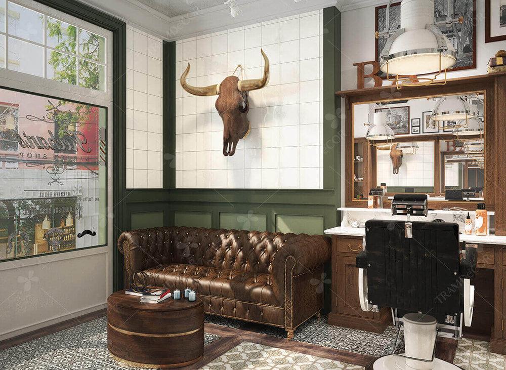 Không gian Barber shop được thiết kế theo phong cách cổ điển kết hợp chút vintage. Phong cách này ưa chuộng chất liệu da và gỗ với tối màu với bàn ghế đồ đạc được thiết kế cầu kì, bắt mắt.