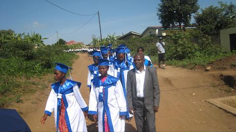 Sewing Center Graduates with the teacher of tailoring, Desire.