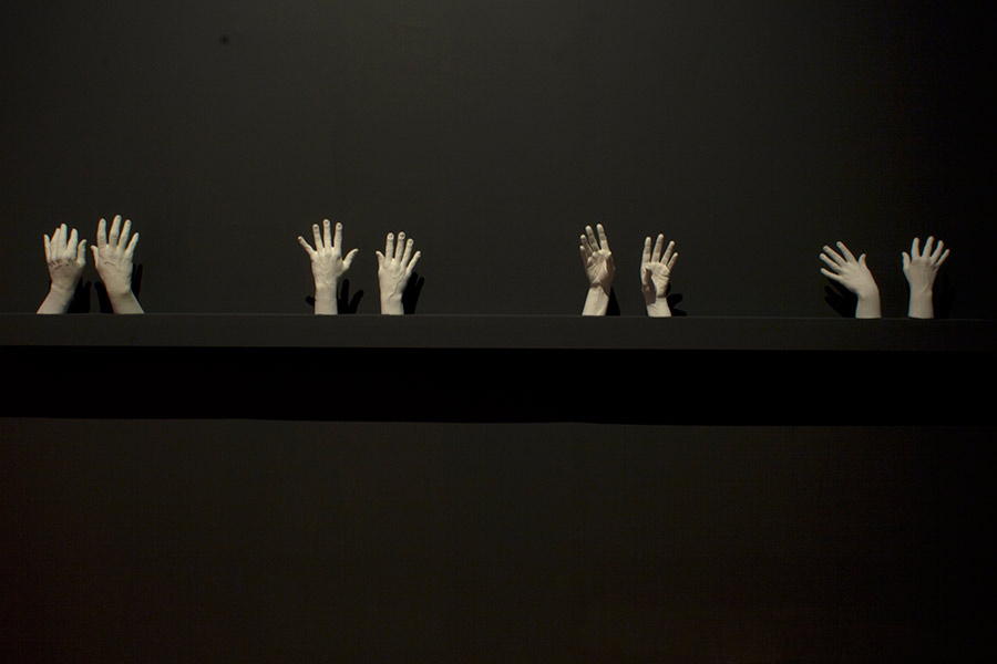 Almost Lovers Always Do. 19'W x 13'L x 1'D Digital print, projection of modified silver gelatin prints, cast plaster hands. (2012)