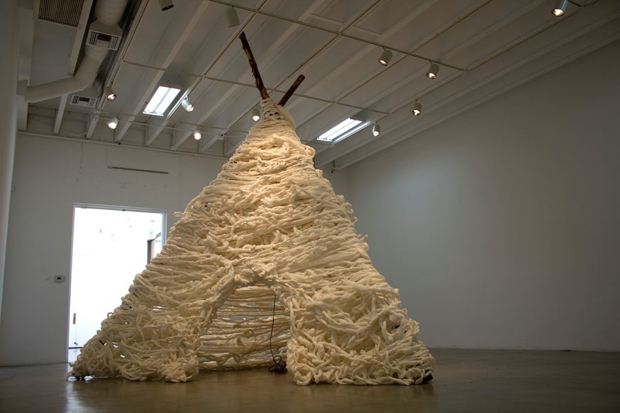 "Many Truths. 192""H x 144""W x 138""D. Pine Logs, Natural Manila Rope, Tracing Paper. (2014)"