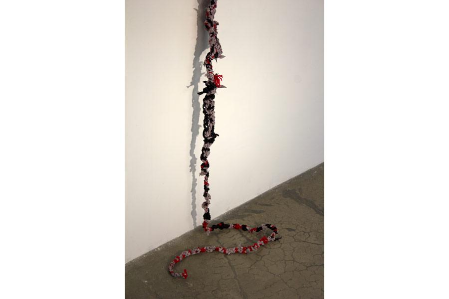 """Cinderella. 192""""H x 36""""W x 6""""D. Ribbon, String, Yarn. (2014)"""