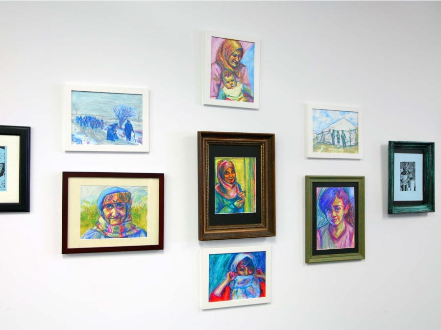 Installation view of pastel drawings by Paige Emery.