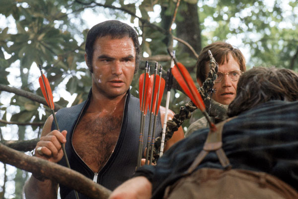 Deliverance - 1972, John BoormanFour city-dwelling friends (Jon Voight, Burt Reynolds, Ned Beatty, Ronny Cox) decide to get away from their jobs, wives and kids for a week of canoeing in rural Georgia. When the men arrive, they are not welcomed by the backwoods locals, who stalk the vacationers and savagely attack them in the woods. Reeling from the ambush, the friends attempt to return home but are surrounded by dangerous rapids and pursued by a madman. Soon, their canoe trip turns into a fight for survival.