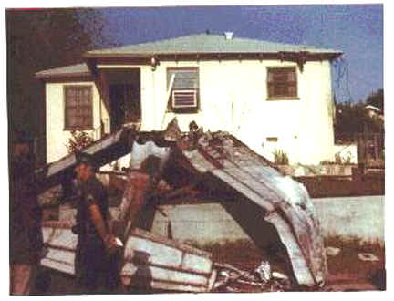 The 1974-1975 plane crash.  Here's the photo! I had to clear out a bunch of boxes and there it was.  The home it crashed into was on Silverton between Wyngate and Apperson, closer to Wyngate and on the East side of the street. I'm sure a drive by that area would reveal the actual house, it can't have changed that much.  I see some rope/cord in the photo, not sure if it's electrical wires from the house or the ropes that the plane used to carry the banner, but the story was that the airplane was carrying a banner too low and it got tangled in some power lines on Apperson (I seem to recall seeing banner debris in the power lines on the south side of Apperson to the west of Silverton, between Samoa and Pinewood).  Please let me know that you received the photo O.K., and let me know, also, if you have any other questions. I remember I was the only one there at the time with a camera, so this may be the only photo?  Sheryl Heyser , VHHS 1978