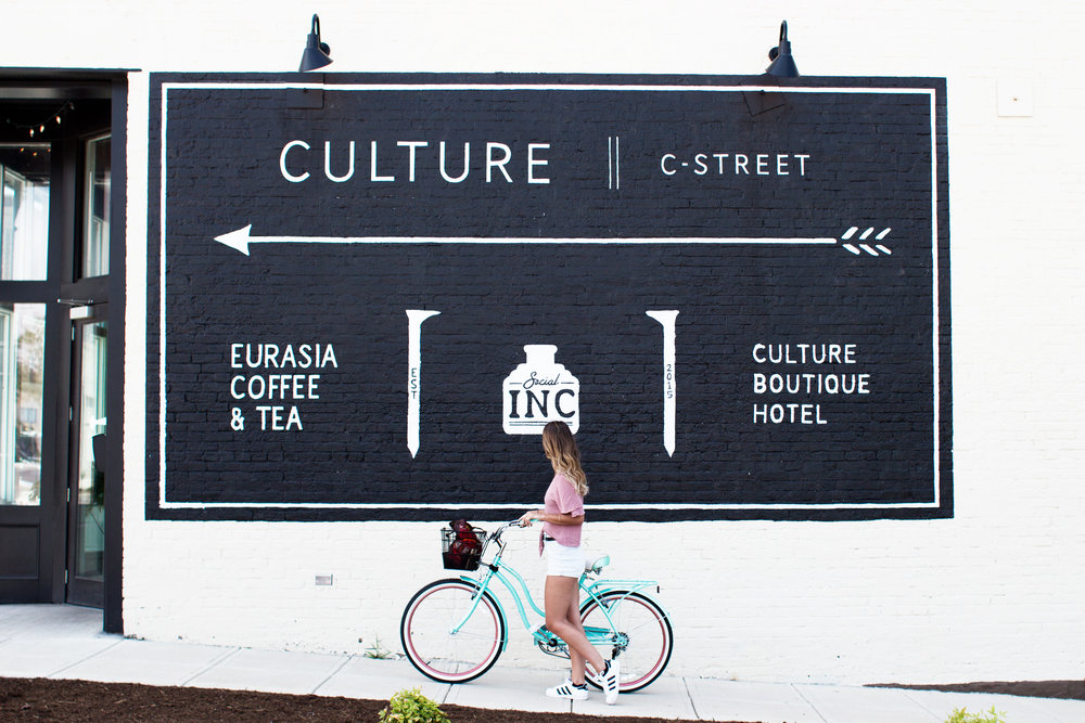 branding street sign woman on bicycle